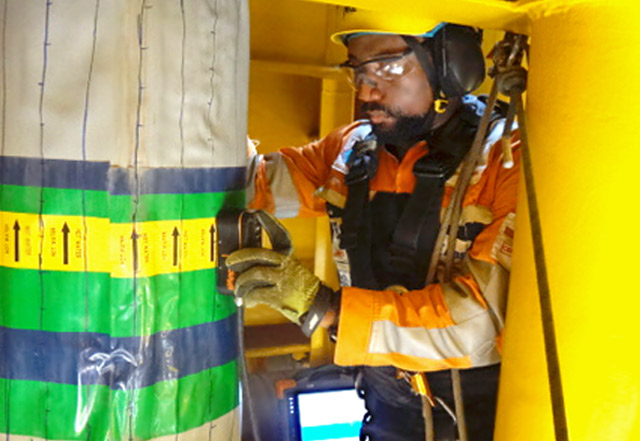 RusselSmith Inspector performing a Pilsed Eddy Current Inspection